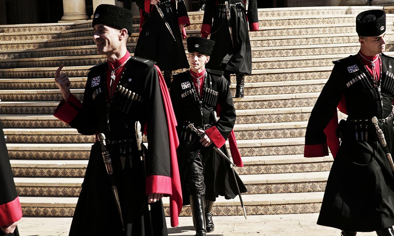 Circassian guards leave Basman Palace. ─ AP