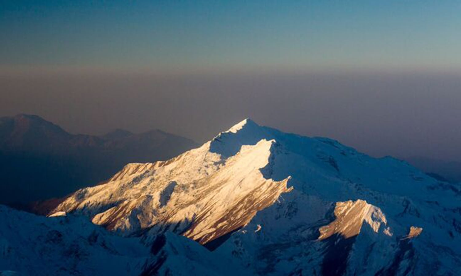 The mighty Nanga Parbat soars high in the first light of the sun. —Photo by Ghulam Rasool