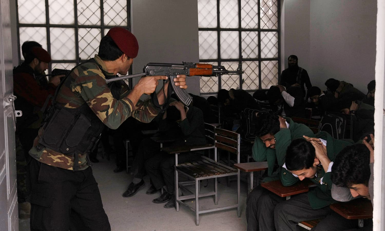 A police commando takes part in a security drill at a local school in Peshawar. —AP