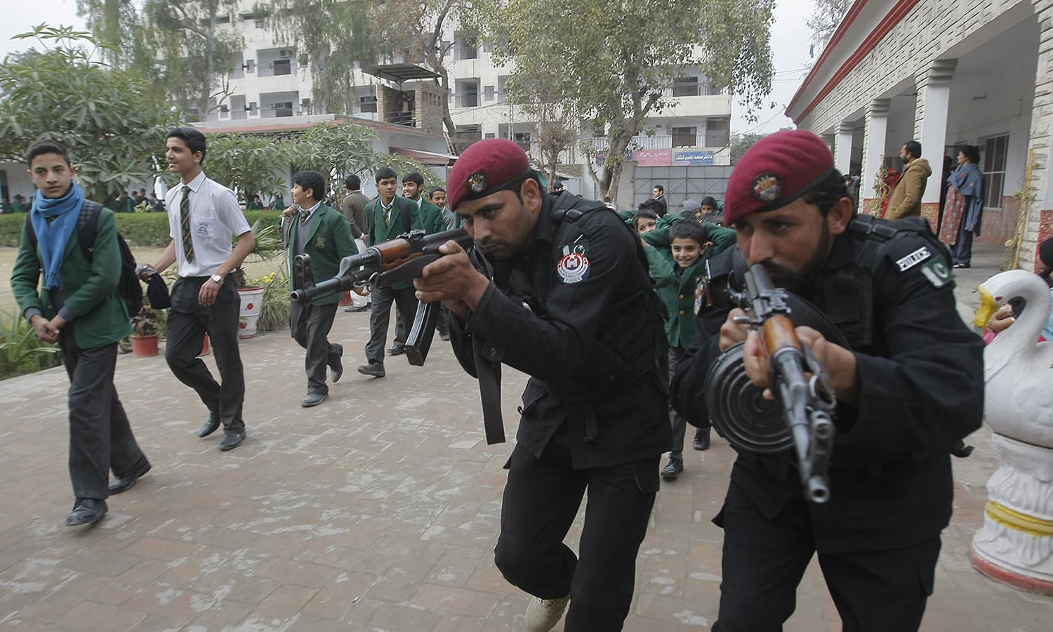 Police commandos take part in a security drill at a local school in Peshawar. —AP
