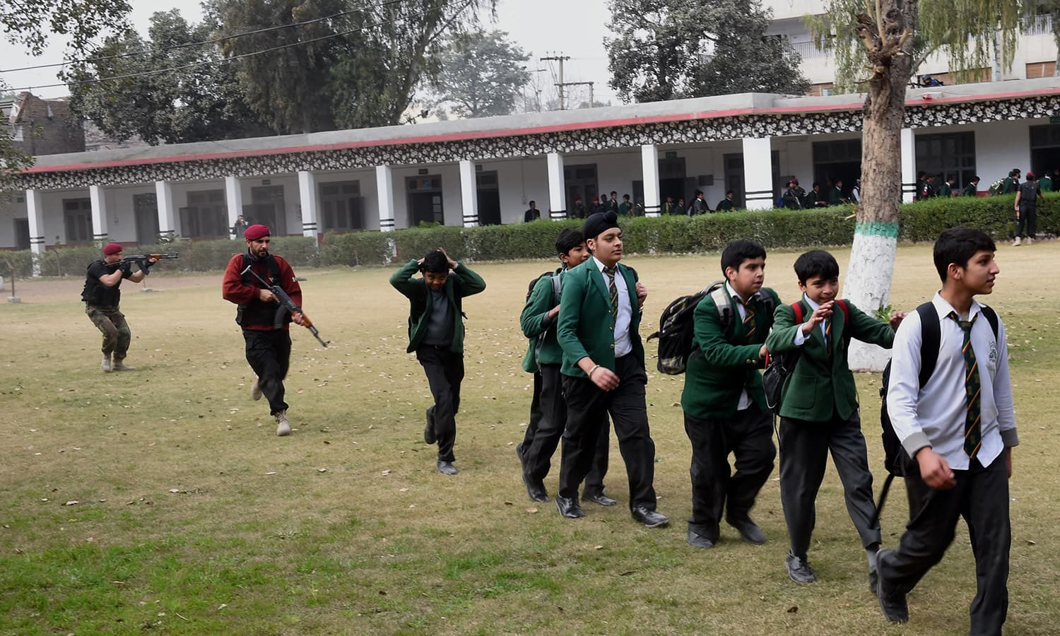 Students form a queue during a security drill at a school in Peshawar. —AFP