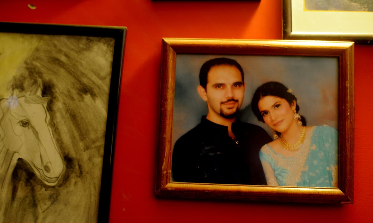 A photograph of Jami with his wife adorns a wall of their home   Arif Mahmood, White Star