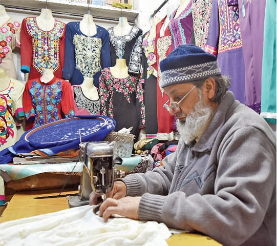 Mohammad Hussain, 64, has been working as a tailor in this market for around 35 years and has seen many changes in that time.