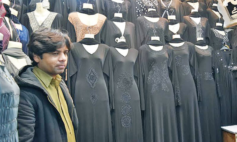 Abayas are sold alongside readymade clothes at the market.