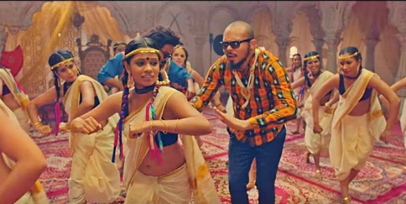 Yup, this guy is just trying to fit in - Indians don't walk, they jive! - Screenshot from Major Lazer's Lean On