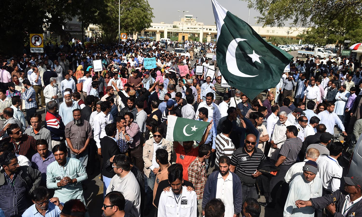 PIA employees march during a protest in Karachi. ─AFP
