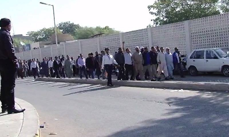PIA employees protest outside the airlines' Karachi headquarters on Wednesday.—DawnNews