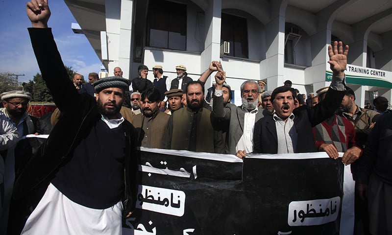 PIA employees protest against the airline's  privatisation at its offices in Peshawar. ─Reuters
