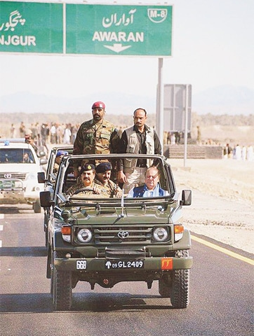 HOSHAB: The picture provided by ISPR shows Army Chief Gen Raheel Sharif occupying the driver's seat while taking Prime Minister Nawaz Sharif on the newly-built 193km Gwadar-Turbat-Hoshab motorway on Wednesday.—Online