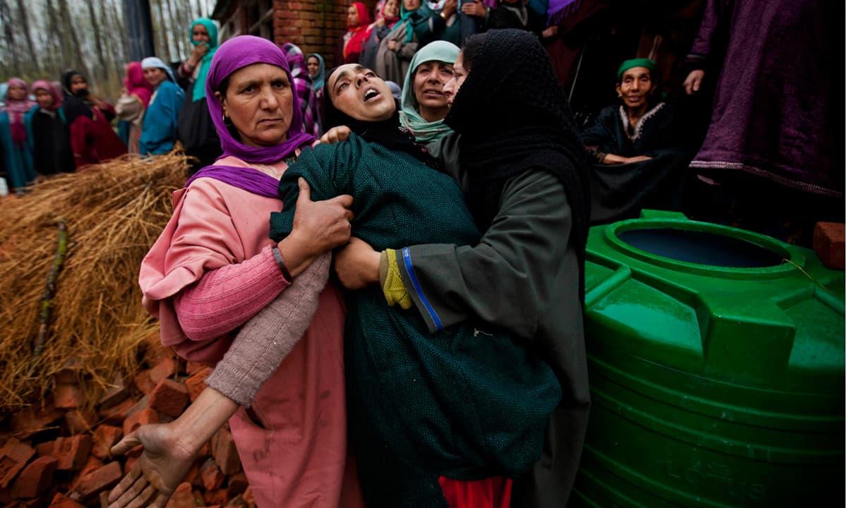 Women grieve the killing of an alleged Kashmiri militant   Dar Yasin, AP