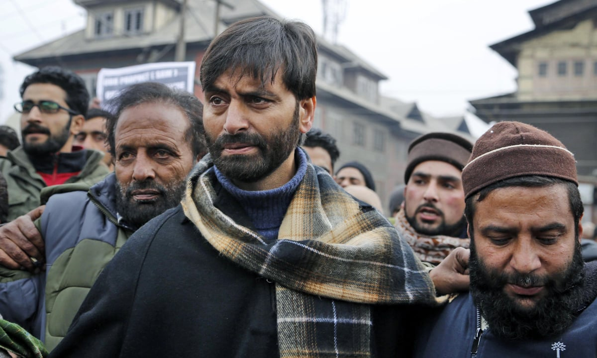 JKLF Chairman Yasin Malik, centre, attends a memorial service to mark the anniversary of an alleged massacre in Srinagar | Mukhtar Khan, AP