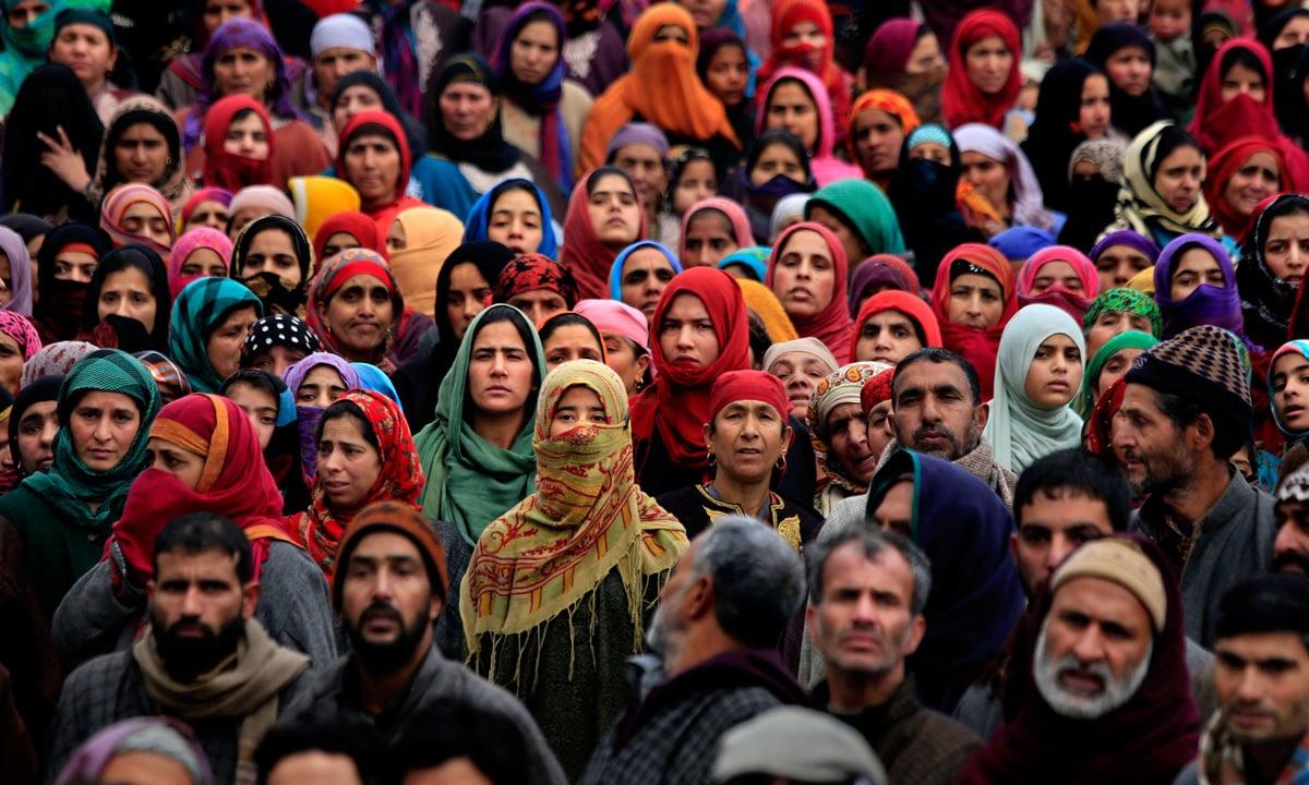 Kashmiris watch the funeral procession of a local militant   Dar Yasin, AP