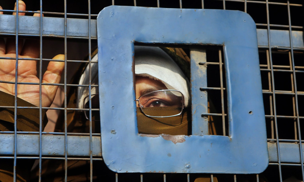 A Kashmiri woman being taken away in a police van | Mukhtar Khan, AP