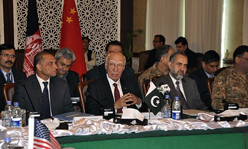 National Security Advisor Sartaj Aziz (C) chairs the third round of four-way peace talks  with Afghanistan, US and Chinese delegates in Islamabad. — APP
