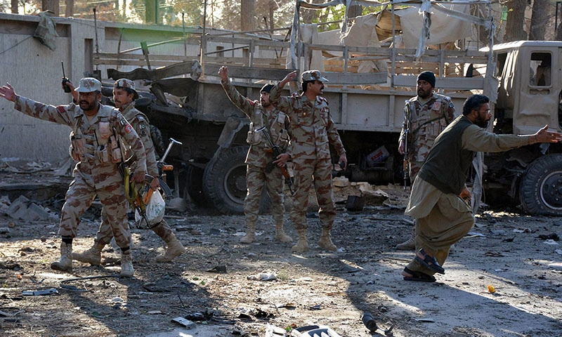 Paramilitary soldiers cordon off the site of the bomb explosion.─AFP
