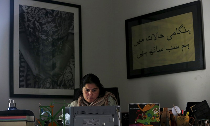 Pakistani journalist and filmmaker Sharmeen Obaid-Chinoy works on her computer at her office in Karachi, February 4, 2016.—Reuters