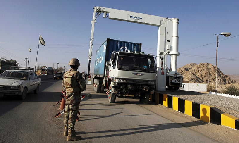 Soldiers scan the contents of a truck at a checkpoint on the main highway outside Quetta. -Reuters