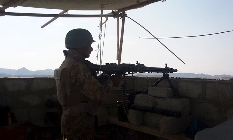 A soldier mans a gun at a check post of a construction site on the outskirts of Gwadar. -Reuters