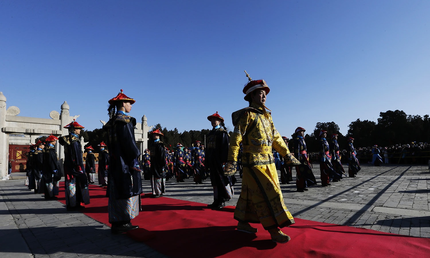 Qi Xue'en, right, a performer dressed as a Qing Dynasty emperor, participates in the ancient Qing Dynasty ceremony in which emperors prayed for good harvest and fortune at a temple fair. ─ AP