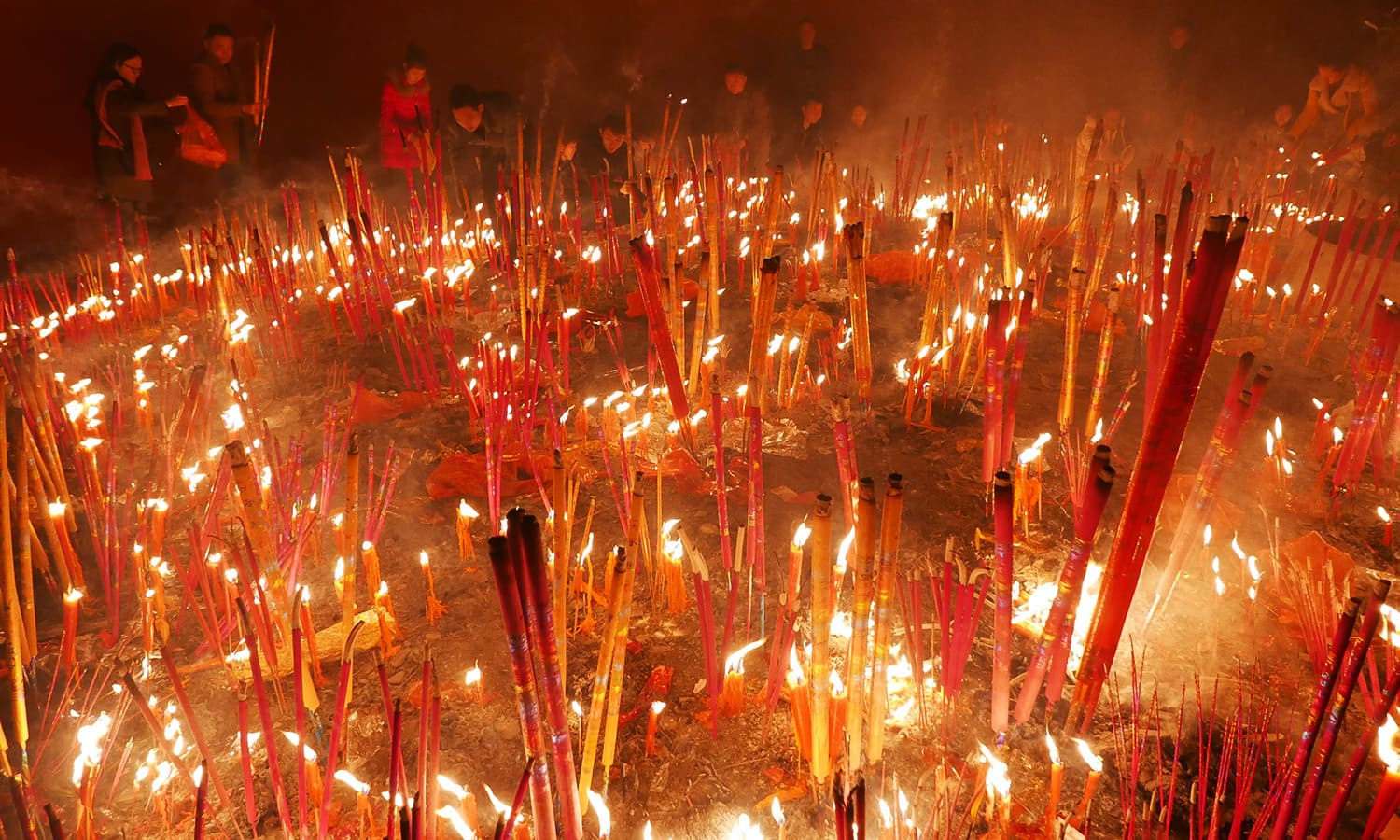People burn incense as they pray for good fortune on the first day of the Chinese Lunar New Year. ─ Reuters