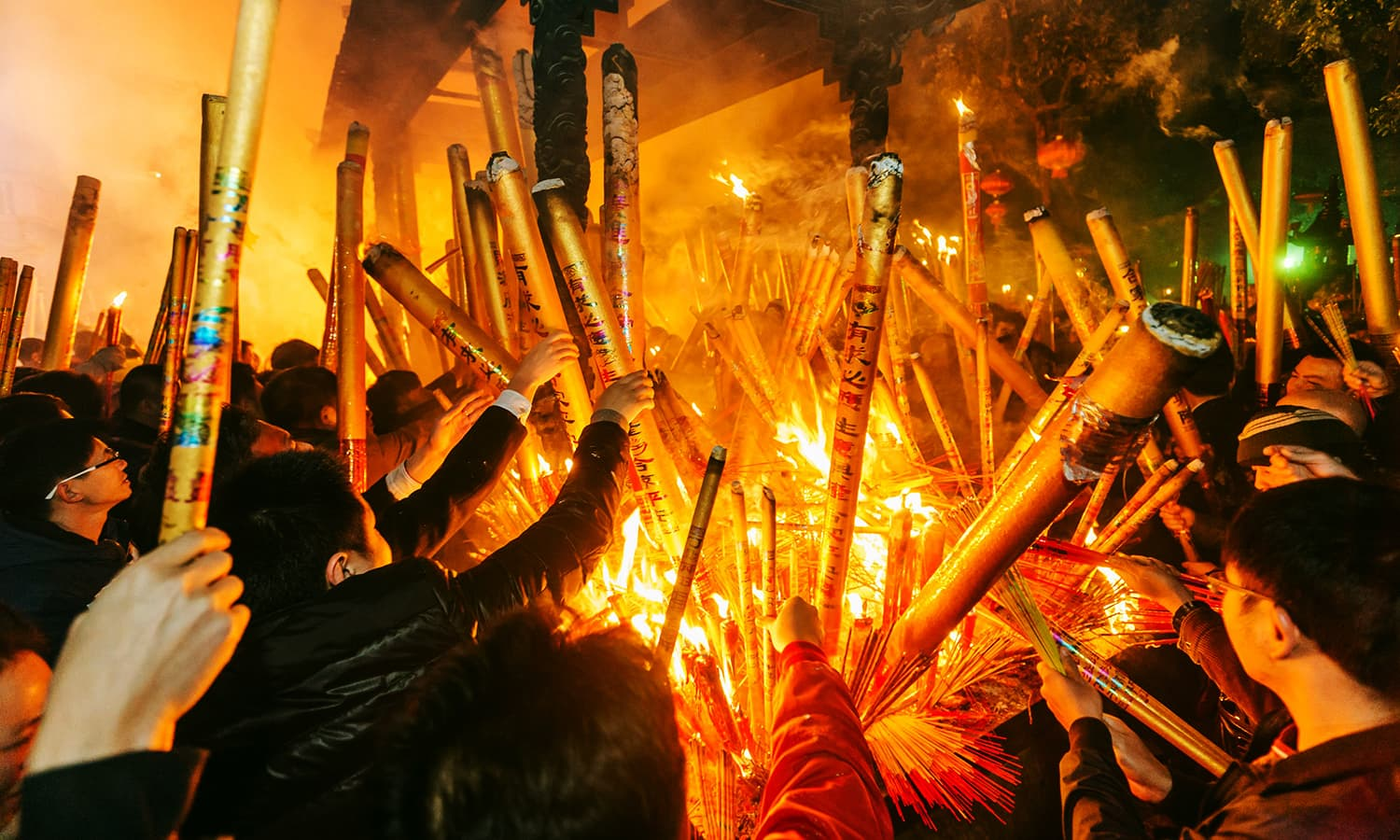 People burn incense as they pray for good fortune at the beginning of the first day of Chinese Lunar New Year. ─ Reuters