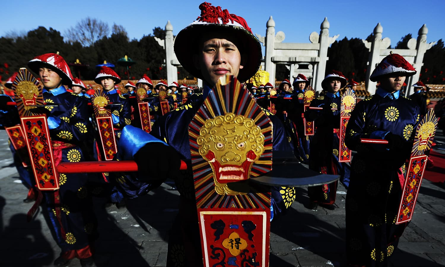 Performers dressed as a Qing Dynasty servants participate in the ancient Qing Dynasty ceremony in which emperors prayed for good harvest and fortune at a temple fair in Ditan Park during the first day of the Chinese Lunar New Year in Beijing, Monday, Feb. 8, 2016. Millions of Chinese began celebrating the Lunar New Year, which marks the Year of the Monkey on the Chinese zodiac. ─ AP