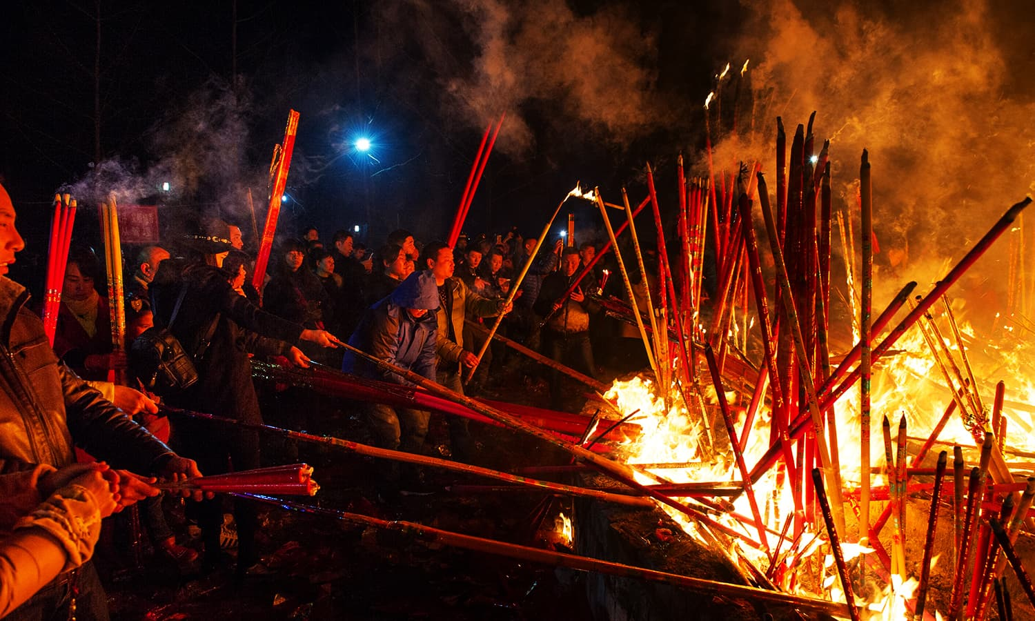 People burn incense as they pray for good fortune at the beginning of the Chinese Lunar New Year, at Wuyou temple in Leshan, Sichuan province, February 8, 2016. ─ Reuters