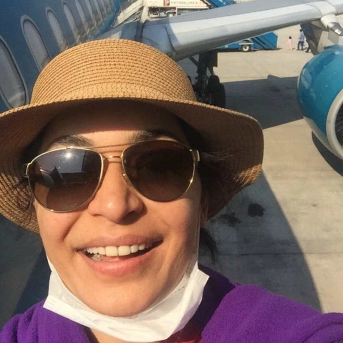 Meera about to board her flight. Photo: Twitter
