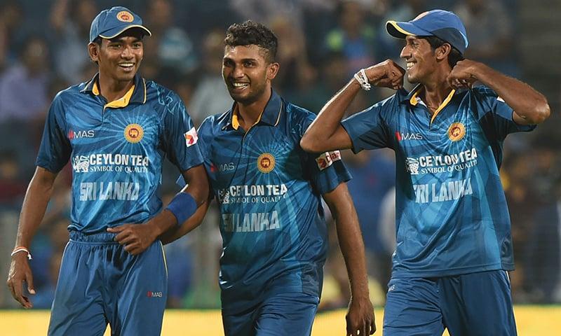 Sri Lanka's bowlers Dusmantha Chameera (L), Dasun Shanaka (C) and Kasun Rajitha share a light moment Singh during the first T20. — AFP