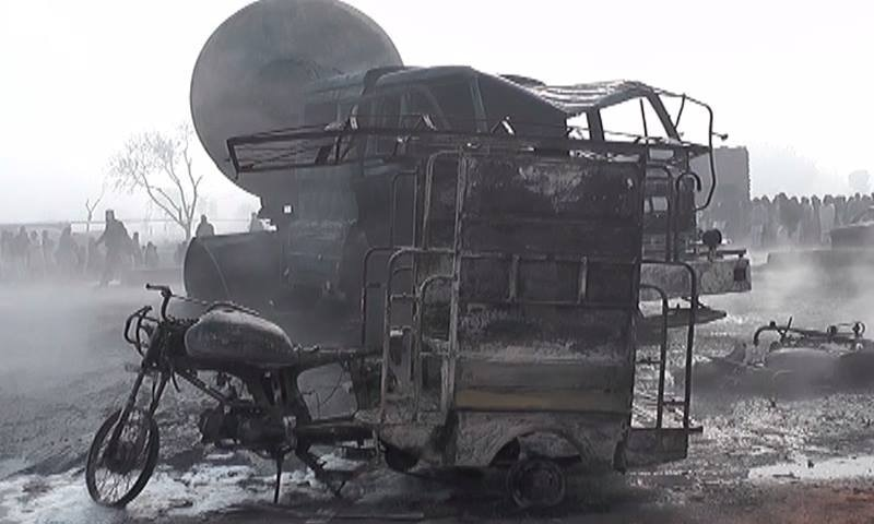 A rickshaw carrying schoolchildren was set ablaze after the collision.—DawnNews
