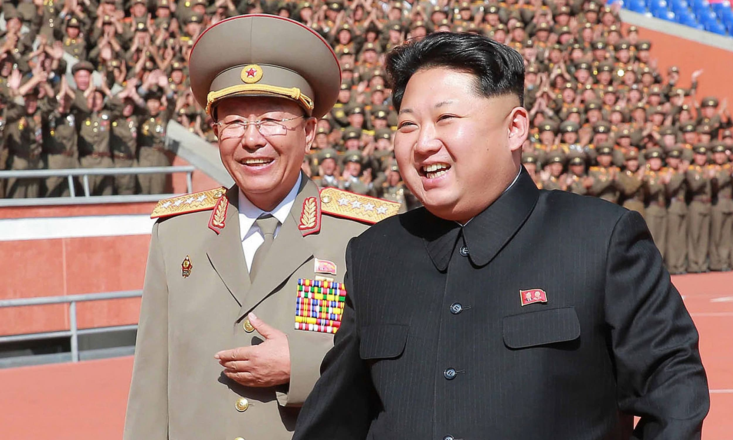The man pictured at left has been identified by South Korea media as Ri Yong-Gil, chief of the Korean People's Army General Staff. -AFP/File