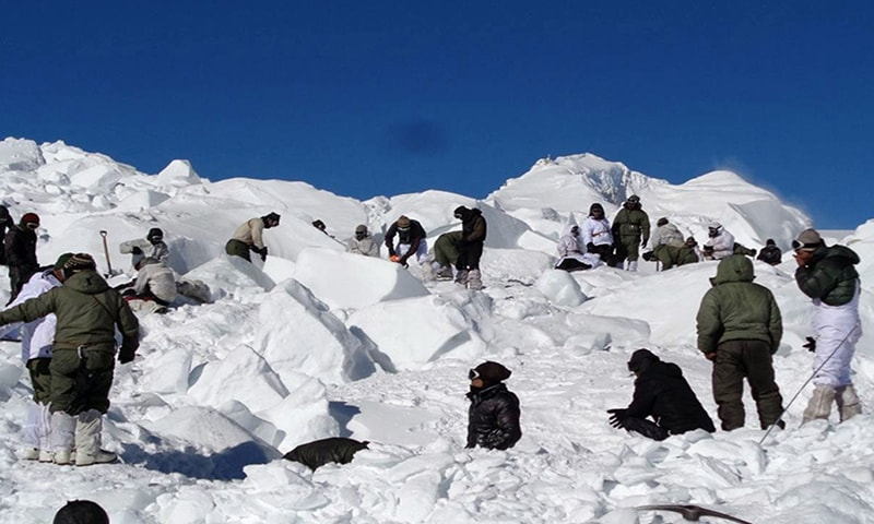"In this handout photograph released by the Indian Defence Ministry on February 8, 2016, Indian army personnel search for survivors after a deadly avalanche on the Siachen glacier. An Indian soldier rescued nearly a week after he was buried by a deadly avalanche on the world's highest battleground was Tuesday airlifted to Delhi in critical but stable condition, the army said. General D. S. Hooda, who heads the Indian Army's northern command, called it a ""miracle"" as he described the huge challenges faced by the resc"