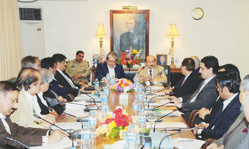 Sindh Chief Minister Syed Qaim Ali Shah presides over a meeting on the K-IV water project at CM House on Thursday. Governor Ishratul Ibad attended the meeting on a special invitation.—PPI