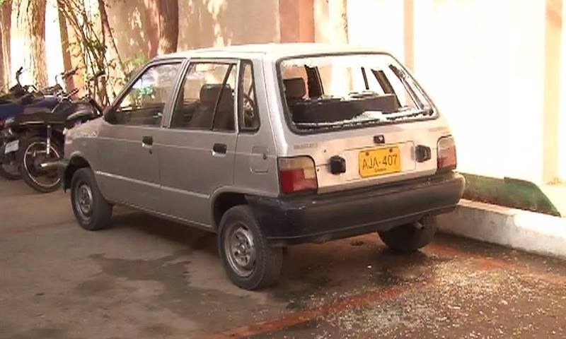 Car belonging to Head Moharir Mobina Town police station partially damaged. ─ DawnNews