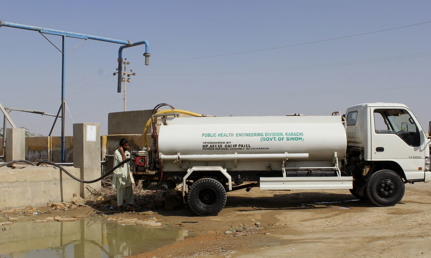 A Reverse Osmosis water desalination plant set up to provide free water to the village instead sells water to government-owned tankers. Residents then purchase tankers of water from the government. ─Photo by the author