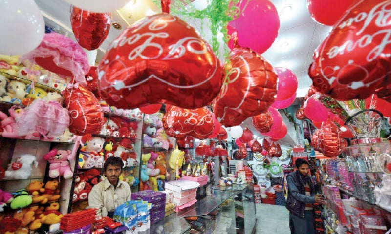A shopkeeper waits for customers at his outlet decorated with Valentine's Day items in Peshawar Saddar. — Photo by Abdul Majeed Goraya