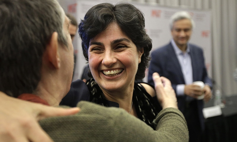Massachusetts Institute of Technology astrophysics professor Nergis Mavalvala, center, celebrates with MIT professor Lorna Gibson, left, following an update by MIT scientists on gravitational waves, Thursday, Feb. 11, 2016, at MIT in Cambridge, Mass. —AP