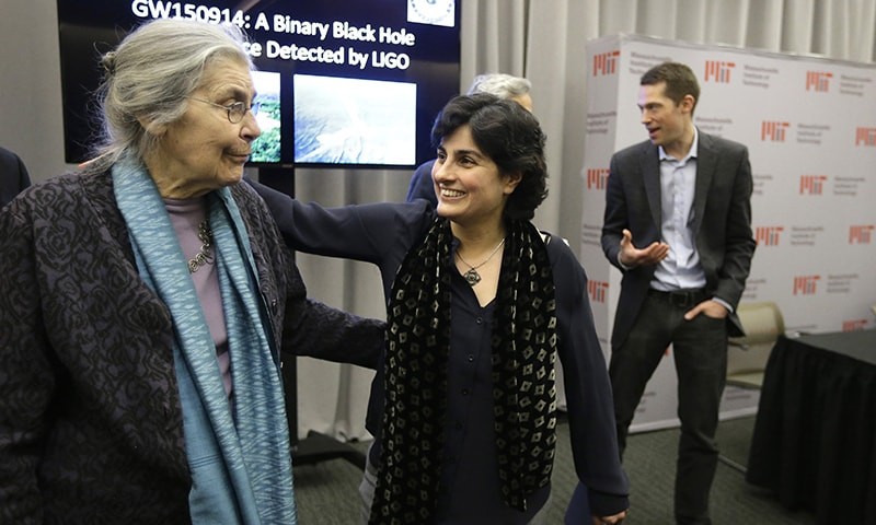 Nergis Mavalvala, center, celebrates with Rebecca Weiss, left, wife of MIT physics professor Rai Weiss, following an update by MIT scientists on gravitational waves, Thursday, Feb. 11, 2016, at MIT in Cambridge, Mass. — AP