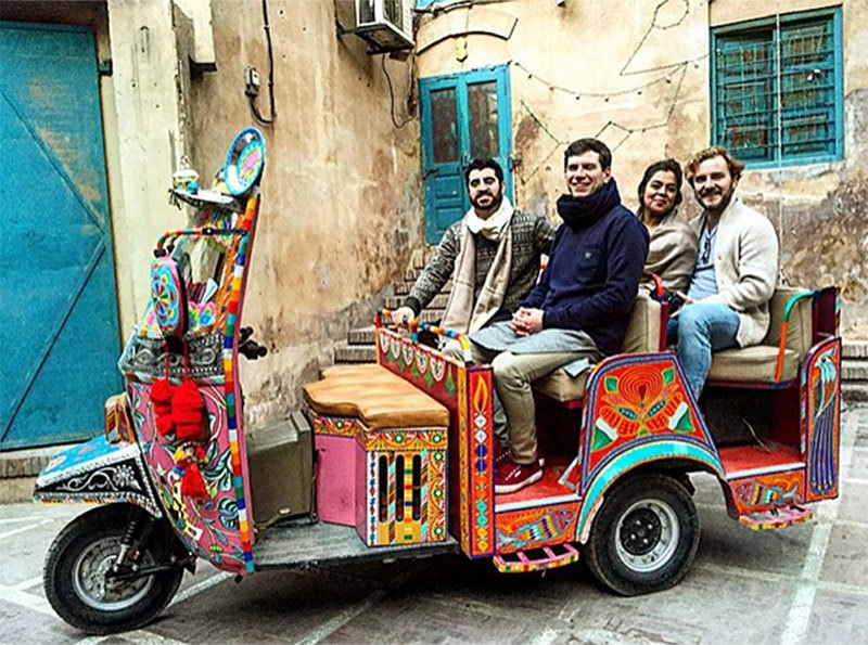Afeef and his friends rode through the streets of Lahore in a multicolored rickshaw. —Photo provided by author