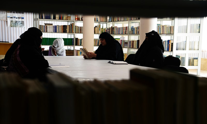 This photograph taken on January 9, 2016 shows Afghan women reading love poems at a poetry club in Kandahar. ─ AFP