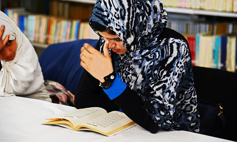 This photograph taken on January 9, 2016 shows Afghan woman Nadia, 20, reading love poems at a poetry club in Kandahar. ─ AFP