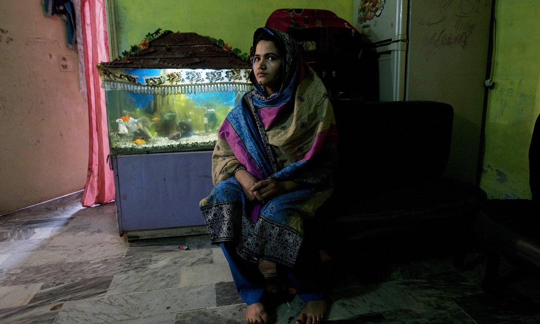 In this photo taken on Jan 26, 2016, Kainaat Soomro sits in her home in Karachi, Pakistan.—AP