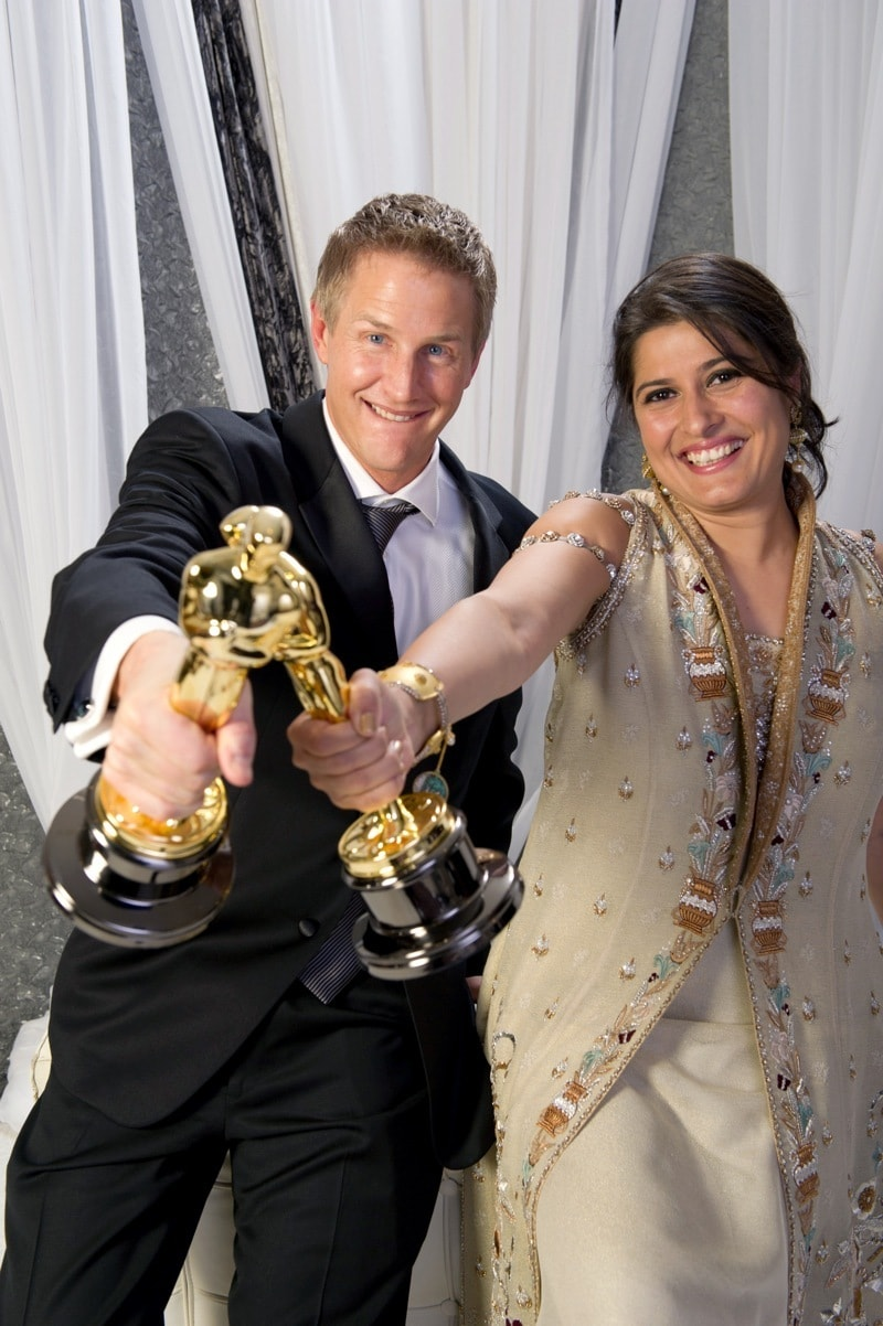 Sharmeen and Saving Face co-director Daniel Junge show off their Oscars at the 2012 Academy Awards - Photo courtesy celebrationofwomen.org