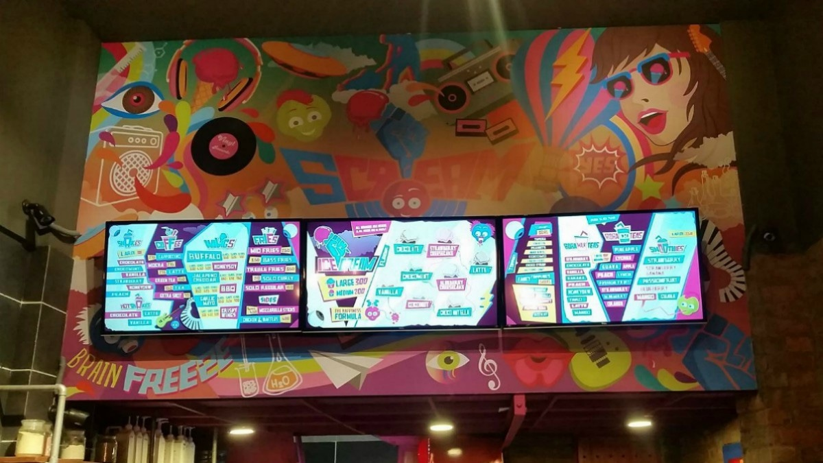 The snazzy decor includes this giant mural by Samya Arif that hangs above the counter