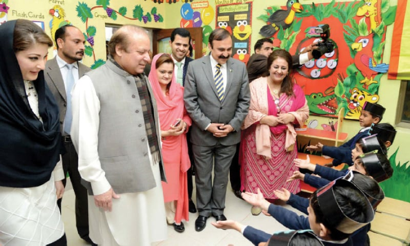 Prime Minister Nawaz Sharif, Minister for CADD Tariq Fazal Chaudhry and Maryam Nawaz watch students perform a tableau during a visit to a model school in Islamabad. — File photo