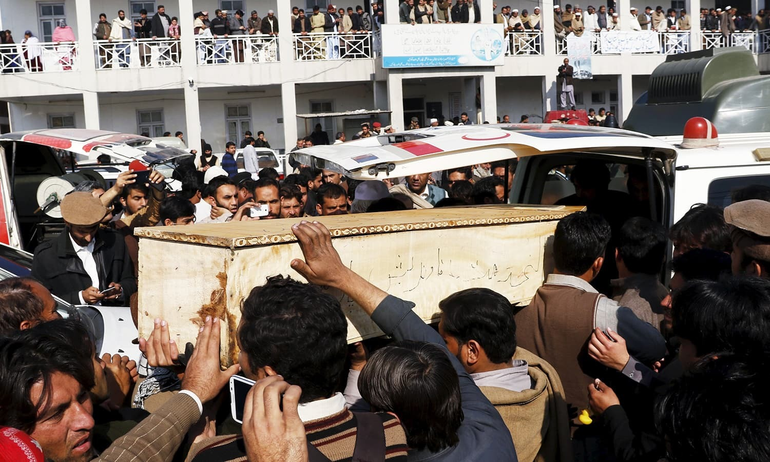 Relatives and friends surround the coffin of a student, who was killed in a militant attack at Bacha Khan University, outside a hospital in Charsadda   Reuters
