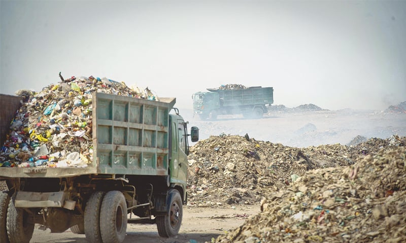 Dumper trucks full of the city's trash are the only traffic one sees at the landfill site.