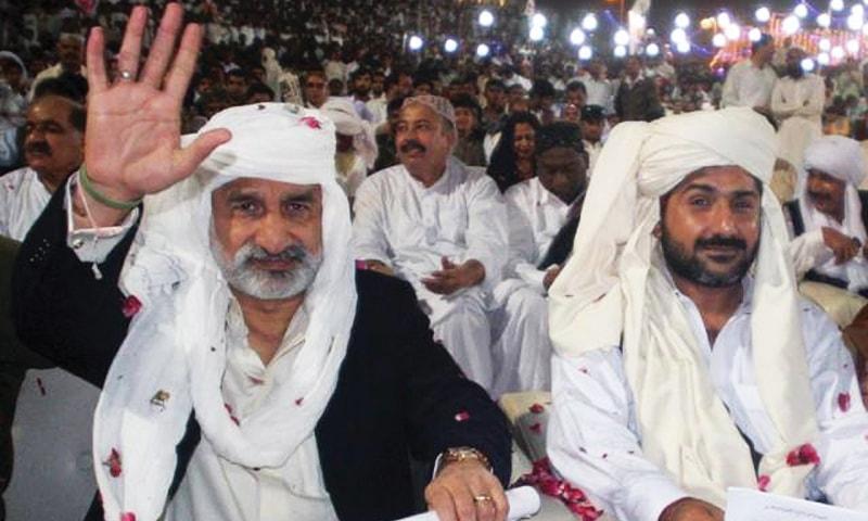 Former Home Minister Zulfiqar Mirza with suspected Lyari gangster Uzair Jan Baloch.—File