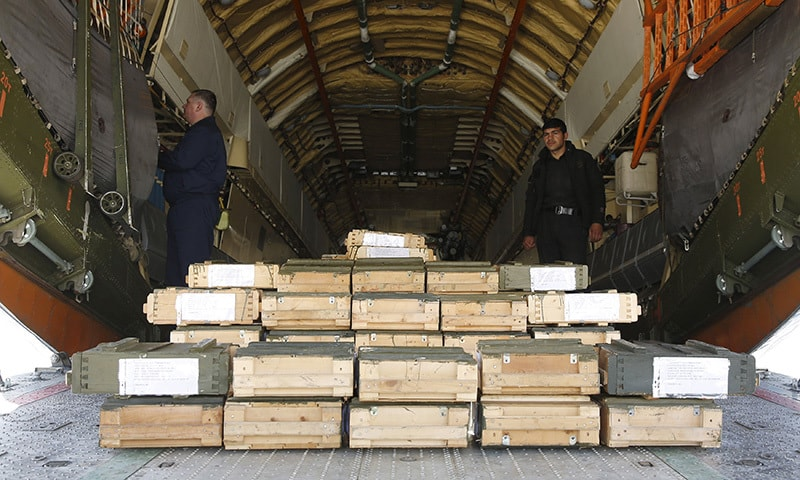 Boxes of ammunition are seen inside a Russian aircraft at the International Kabul Airport.─ Reuters