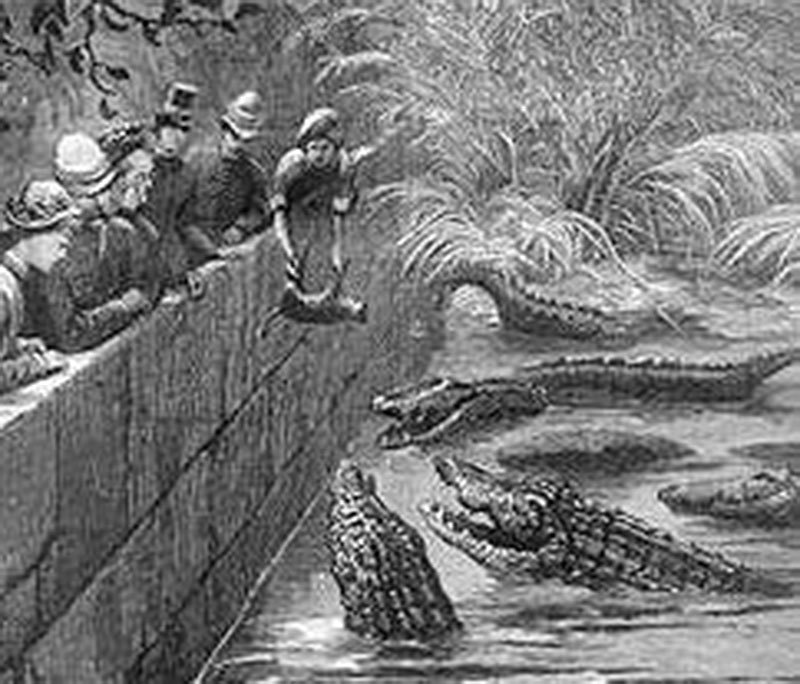 A group of 19th century British men and women feeding the crocodiles at the shrine.